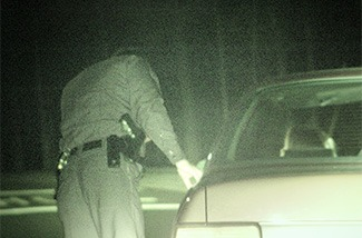 Officer at side of vehicle for traffic stop