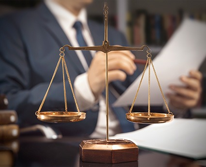 lawyer scale with lawyer in the background